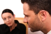 Female therapist listening to a male patient